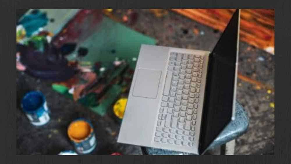 image shows a laptop of an artist and different colors