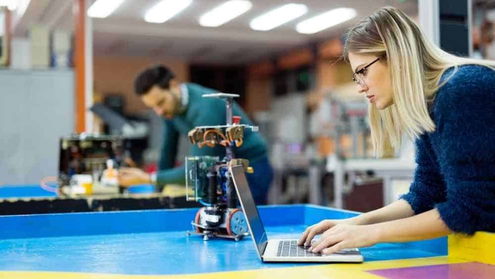 a robotic engineer student using her laptop