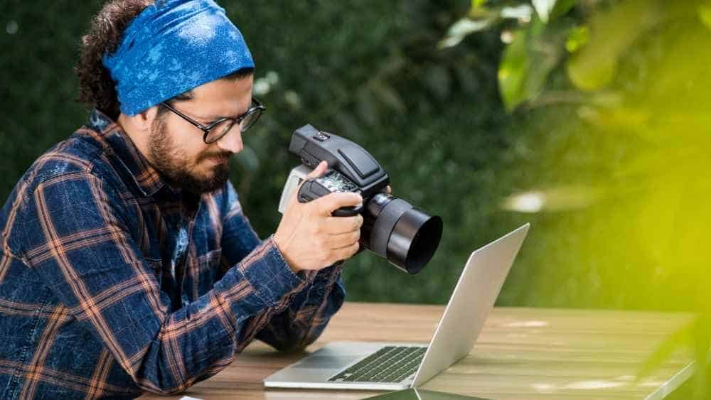 a photographer working on his laptop