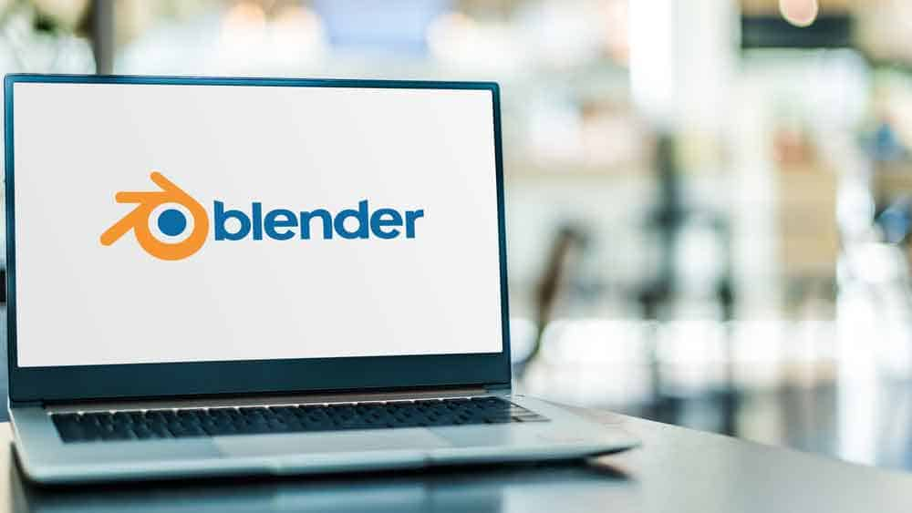 Laptop computer displaying logo of Blender