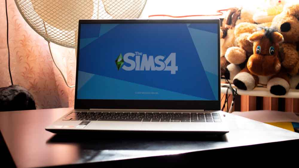 Sims 4 game on laptop close up